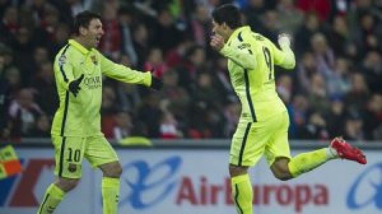 Messi magic moves Barcelona within a point of Madrid
