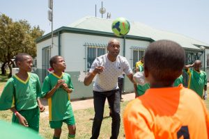 lucas-radebe-playing-with-the-kids